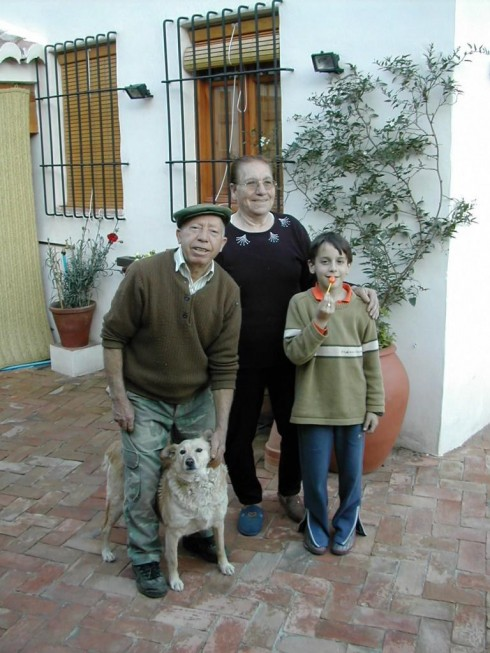 Antonio One and Chon One with grandson Pablo and dog Canela